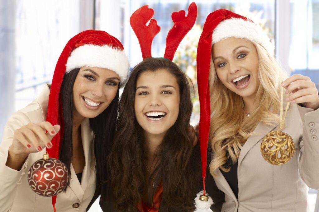 3 women in santa hat